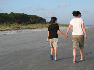 Liam Loren holding hands beach 2